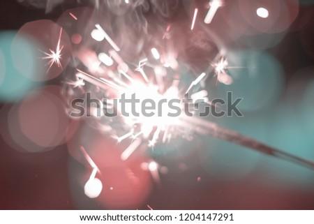 Sparkler Bokeh Colorful sparkler. Night background with a sparkler.  #1204147291
