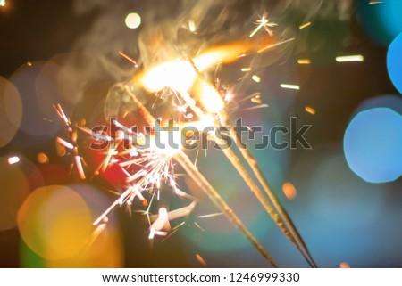 Sparkler Bokeh Colorful sparkler. Night background with a sparkler.  #1246999330