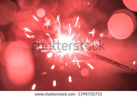 Sparkler Bokeh Colorful sparkler. Night background with a sparkler.  #1398750731
