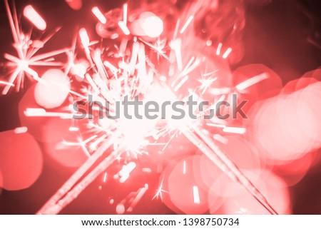 Sparkler Bokeh Colorful sparkler. Night background with a sparkler.  #1398750734