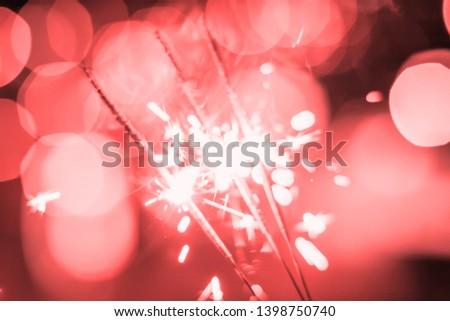 Sparkler Bokeh Colorful sparkler. Night background with a sparkler.  #1398750740
