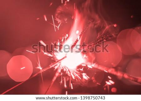 Sparkler Bokeh Colorful sparkler. Night background with a sparkler.  #1398750743