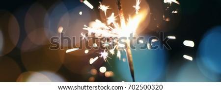 Sparkler  Bokeh Colorful sparkler. Night background with a sparkler. #702500320
