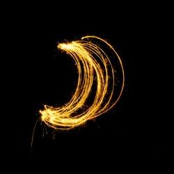 Sparkler firework light with crescent shape isolated on black background.