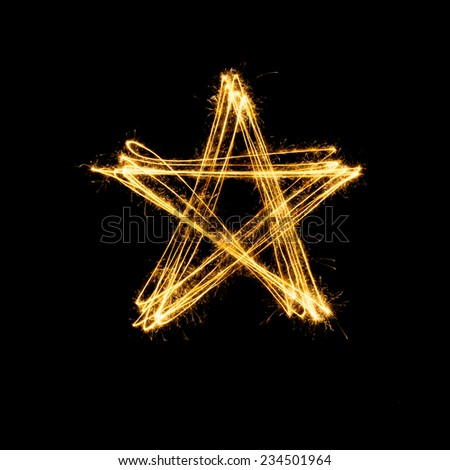 Sparkler firework light with star shape isolated on black background.