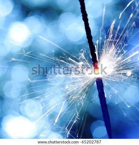 sparkler on blue