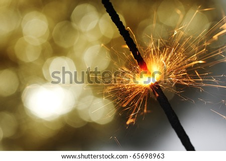 sparkler on gold