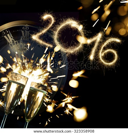 Sparkler 2016 with champagne glasses and countdown clock to midnight