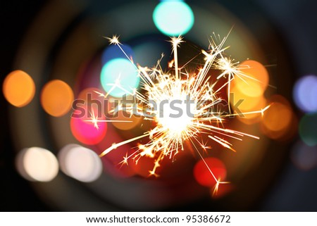 Sparklers and background with colorful bokeh