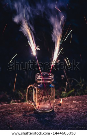 Sparklers fireworks mason jar cup canning night trend fire bright long exposure woods rural stylish aesthetic blog celebration pink light sparks flare creative party dark fun summer holiday