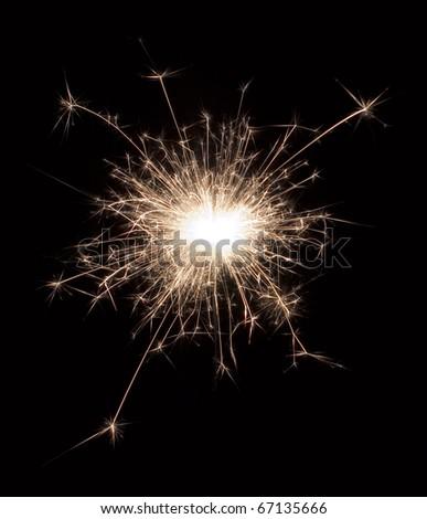 sparklers light is on fire on black background
