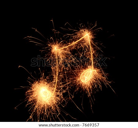 Sparklers notes isolated on black background. Music symbol