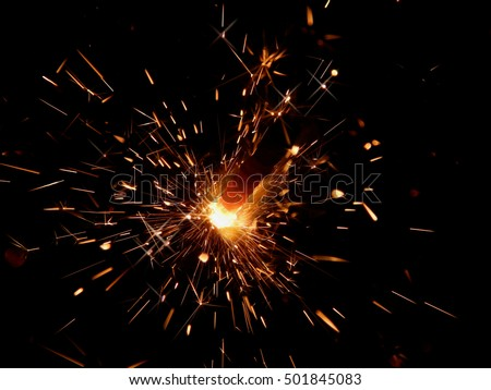 Sparklers with sparks on a black background #501845083