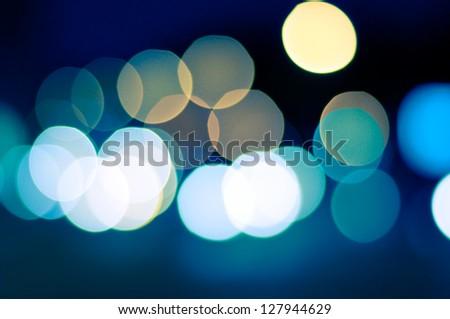 sparkling and defocused lights background. blue bokeh background. abstract blurred lights