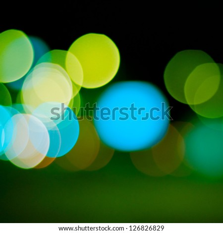 sparkling and defocused lights background. green bokeh background. abstract blurred lights