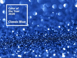 Sparkling background with bokeh made of Classic Blue 2020 color. Color of year 2020 blurred backdrop for holidays and parties. COY2020 Classic Blue concept. Copy space for text