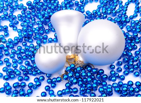 Sparkling Christmas balls decoration on beads, isolated on white background