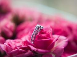Sparkling diamond engagement ring in one of small pink roses great for valentines