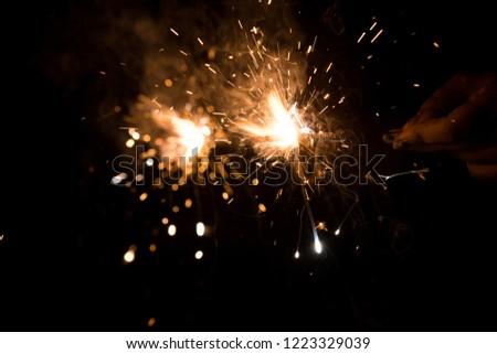 Sparkling firecrackers on diwali celebration #1223329039