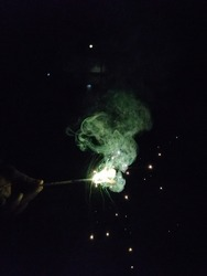 Sparkling green color crackers in black background