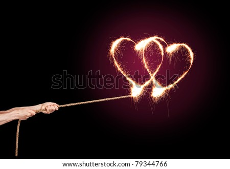 Sparkling Love Heart pulls a pair of hands at the rope.