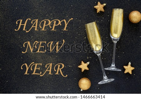 Sparkling New Year background. Card Happy New Year. Beautiful Christmas golden trappings on black background. Glass of champagne. Flat lay composition.  #1466663414