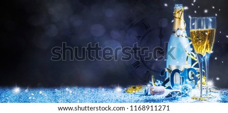 Sparkling New Year background. Champagne Explosion With Toast Of Flutes - Shutterstock ID 1168911271