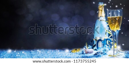 Sparkling New Year background. Champagne Explosion With Toast Of Flutes #1173755245