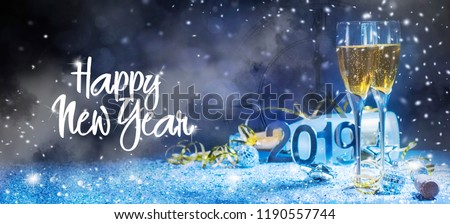 Sparkling New Year background. Champagne Explosion With Toast Of Flutes #1190557744
