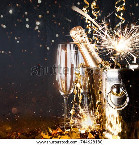 Sparkling New Year background. Champagne Explosion With Toast Of Flutes. Party Feeling with Sparklers and Champagne. New Years Eve celebration  #744628180