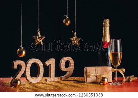 "Sparkling New Year background, copy space. Champagne with decorations on New Year""s Day #1230551038"