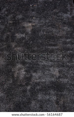 sparkling particles on black asphalt