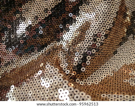 Sparkling sequined textile.