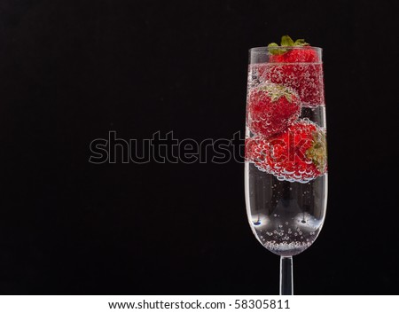 Sparkling Strawberry Drink in Champagne Glass with Custom Space