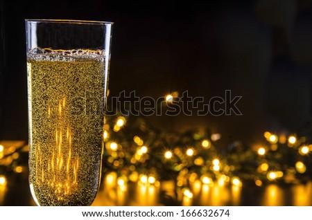 Sparkling Wine and Lights/Evening Celebration/ Glass filled with sparkling wine and lights