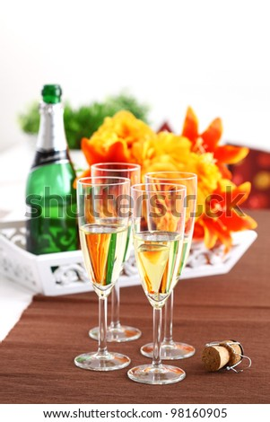 Sparkling wine with bouquet and wine bottle