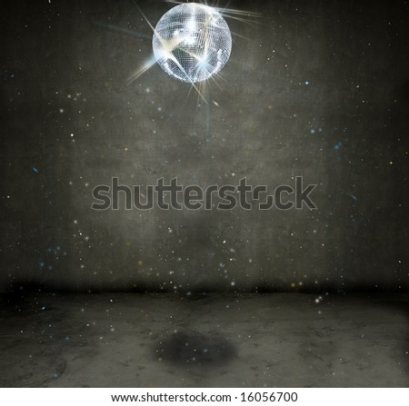 Sparkly disco ball hanging in an empty grungy room