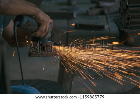 Sparks caused by polishing with a grinder.