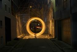 Sparks Flying off Burning Steel Wool in Alleyway