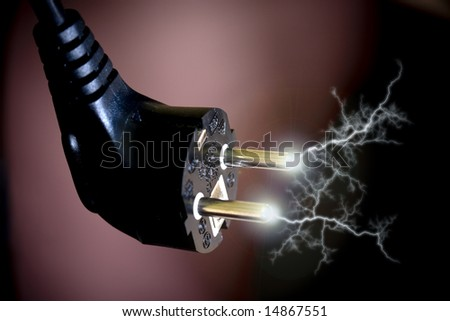 Sparks from an electric plug connector