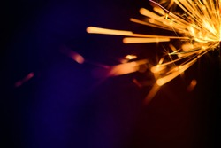 Sparks in the dark. Sparks. Christmas and New Year time. Magic light