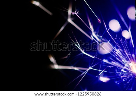 Sparks in the dark. Sparks. Christmas and New Year time. Magic light #1225950826
