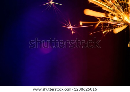 Sparks in the dark. Sparks. Christmas and New Year time. Magic light #1238625016