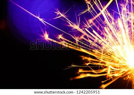 Sparks in the dark. Sparks. Christmas and New Year time. Magic light #1242205951