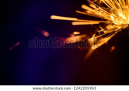 Sparks in the dark. Sparks. Christmas and New Year time. Magic light #1242205963