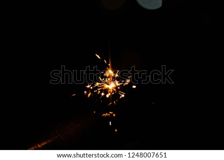 Sparks in the dark. Sparks. Christmas and New Year time. Magic light #1248007651