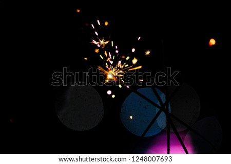 Sparks in the dark. Sparks. Christmas and New Year time. Magic light #1248007693