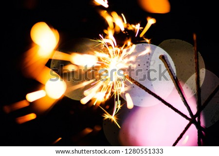 Sparks in the dark. Sparks. Christmas and New Year time. Magic light #1280551333