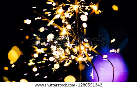 Sparks in the dark. Sparks. Christmas and New Year time. Magic light #1280551342