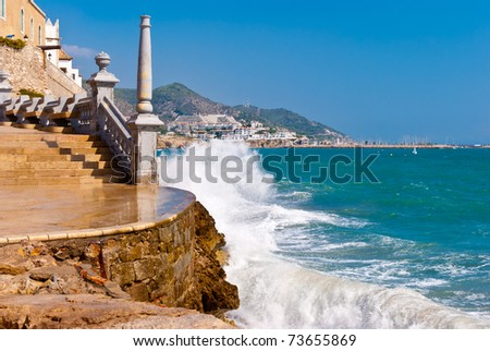 Sparks of breaking wave in Sitges, Spain.